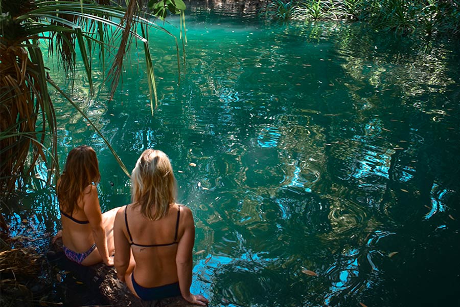 Two women about to take a swim in Berry Springs in NT