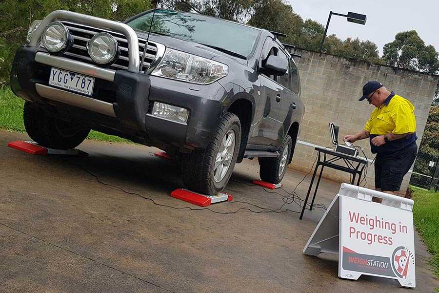 Getting 4WD weighed on scales to ensure it is not over the limit for safety