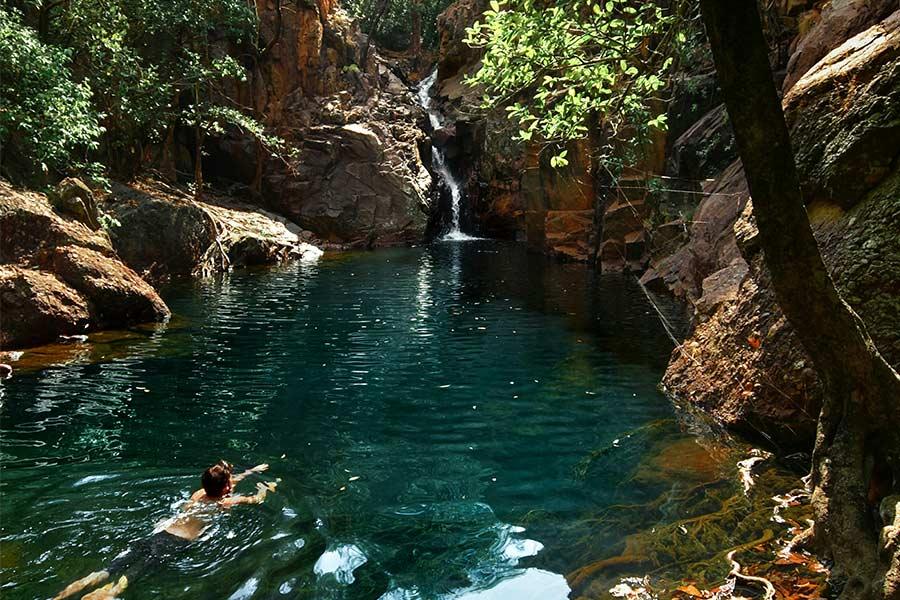 Man swimming in Moline Rockhole in Kakadu, NT