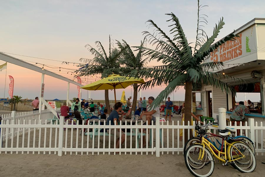 View of a vibrant beach restaurant at sunset