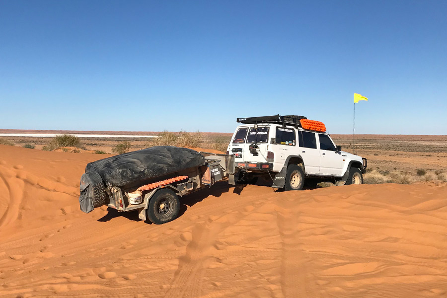 Yellow sand flag attached to vehicle