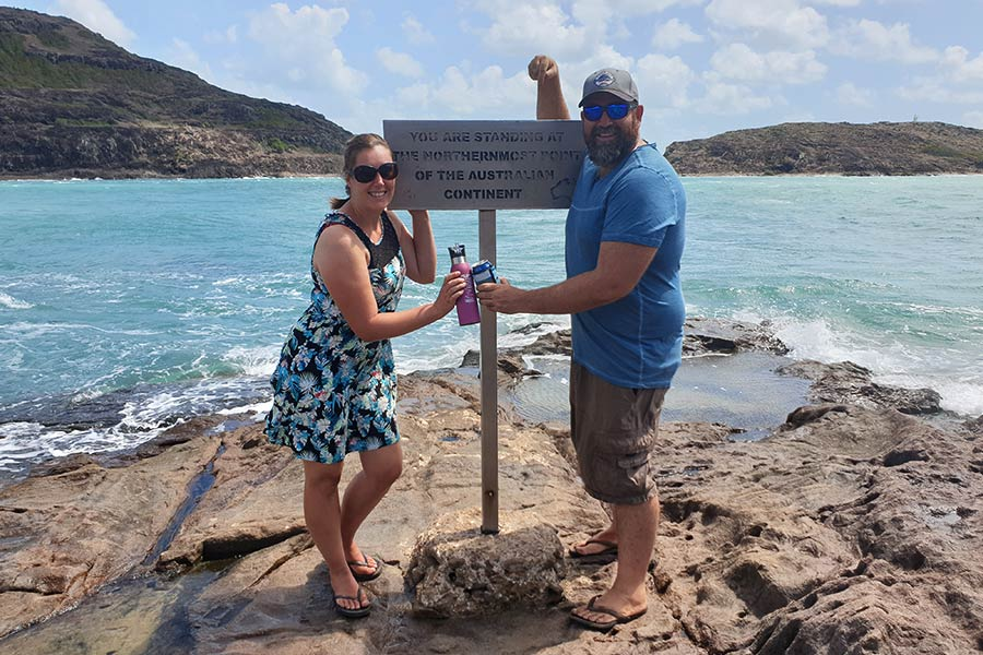Couple standing at the northernmost point of the Australian continent