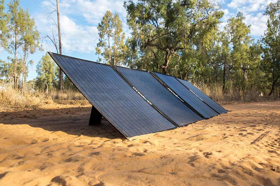 Hard Korr solar panels resting in the sand facing the sun