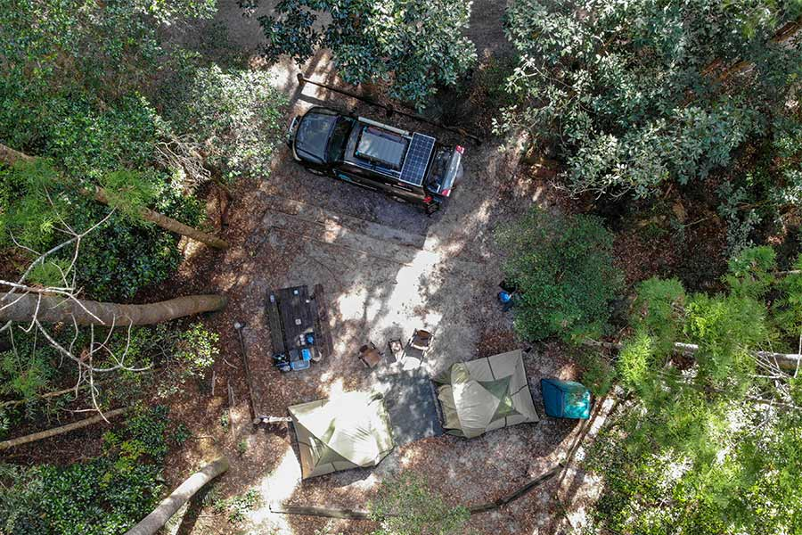 Bird's eye view of camp setup next to 4wd