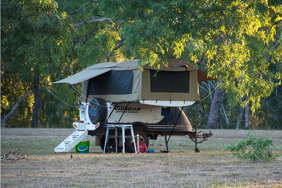 An Ultimate Off-Road Campers camper trailer setup outdoors
