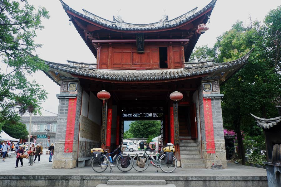View of bicycles underneath temple in China