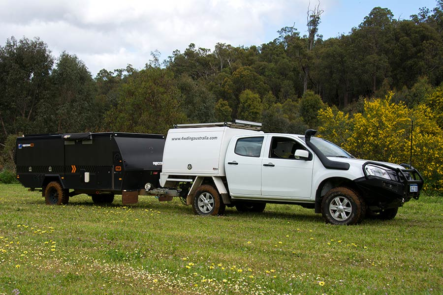 4wd towing camper trailer on grassy terrain