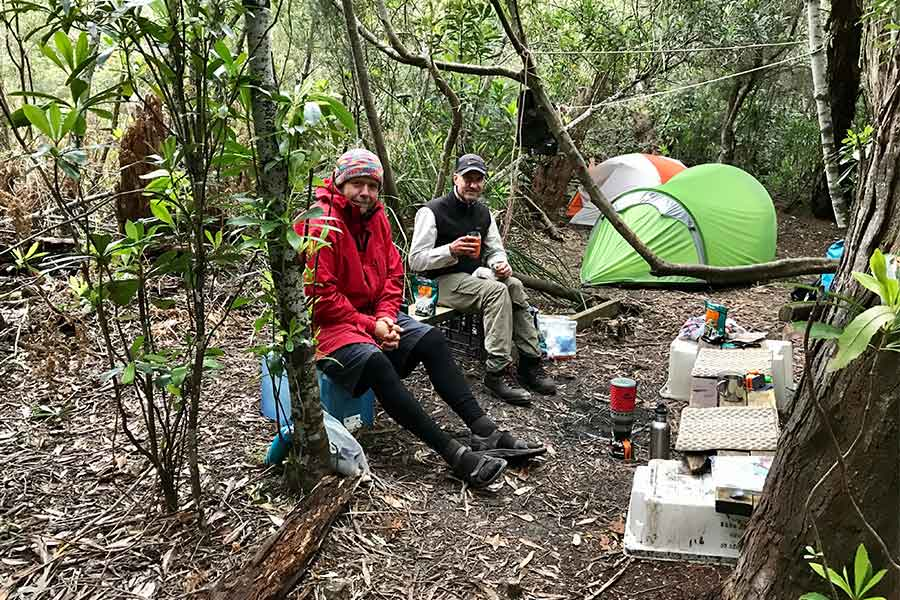 Hikers eating some food at the Prion Crossing Campsite
