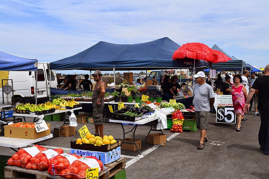 People looking at the produce at an Australian farmer's market