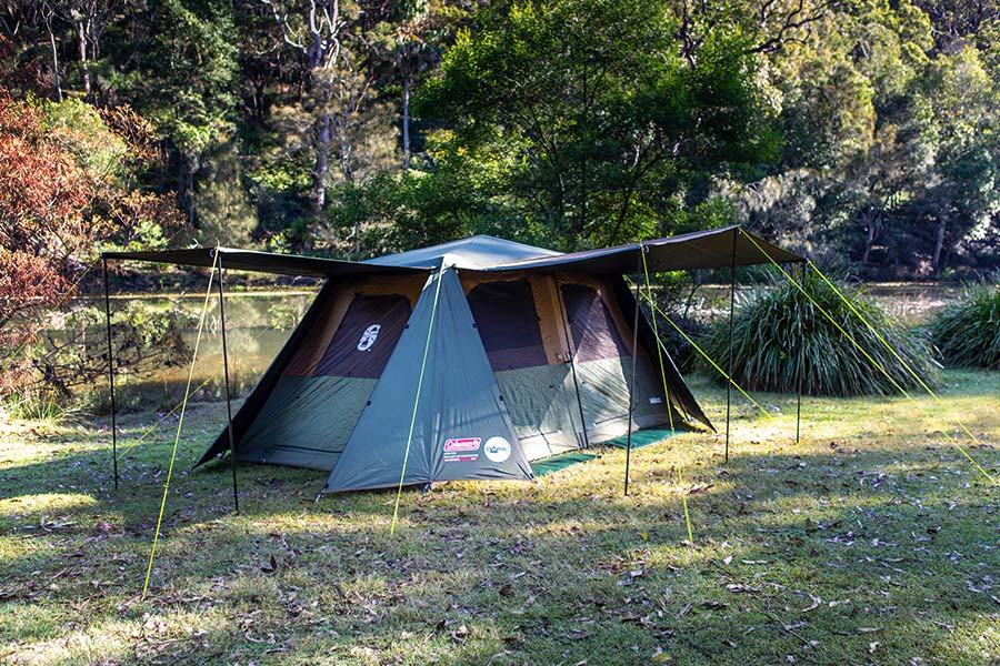 The 8 person Coleman Northstar with it's awnings fully set up, near a river.