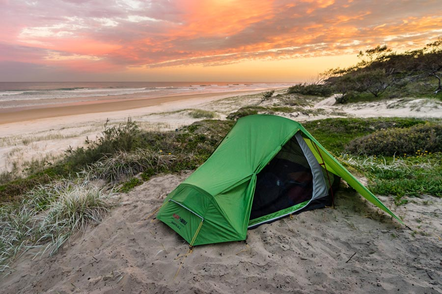 Black Wolf Mantis UL tent set up on sand at a beach site