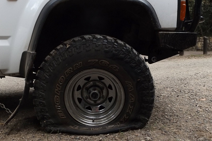 Flat black tyre resting on the ground