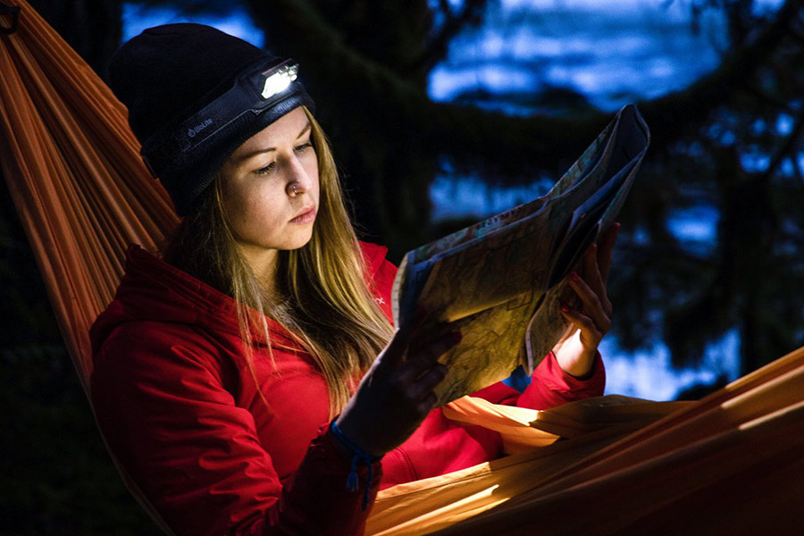 Woman reading while using her BioLight headlight