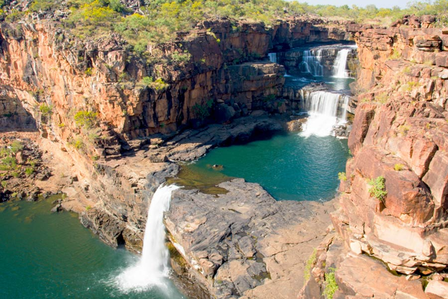 An aerial view of remote cascading waterfalls