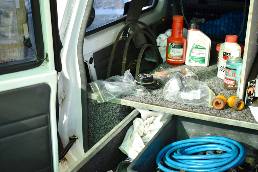 Hoses, oil and other spare parts in the back of a 4WD