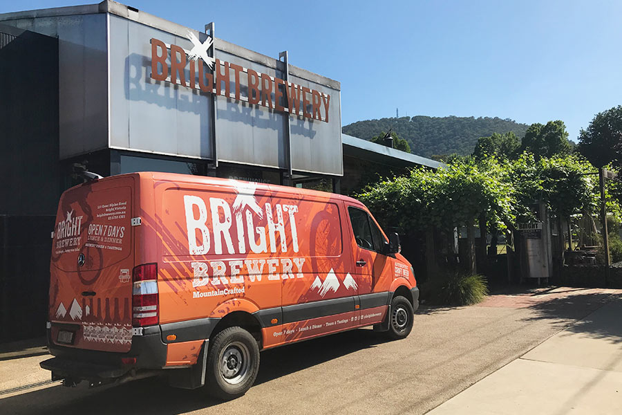 A red van with Bright Brewery signage is parked out the front of Bright Brewery