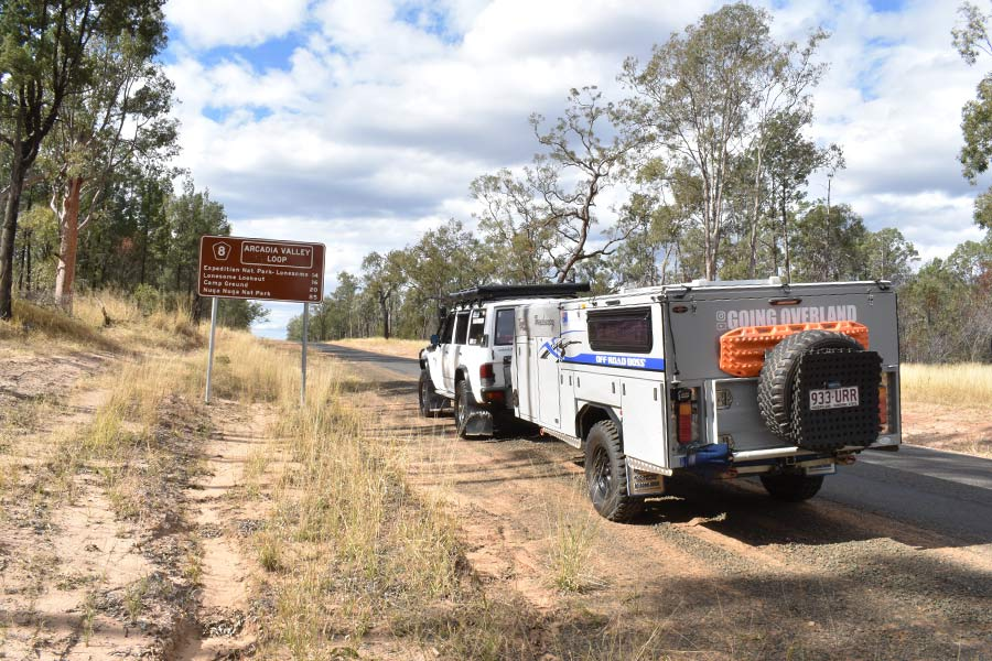 A 4WD and camper trailer stop by the side of the road on the way to Expedition National Park