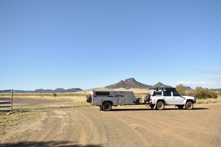 A 4WD and camper trailer in a National Park