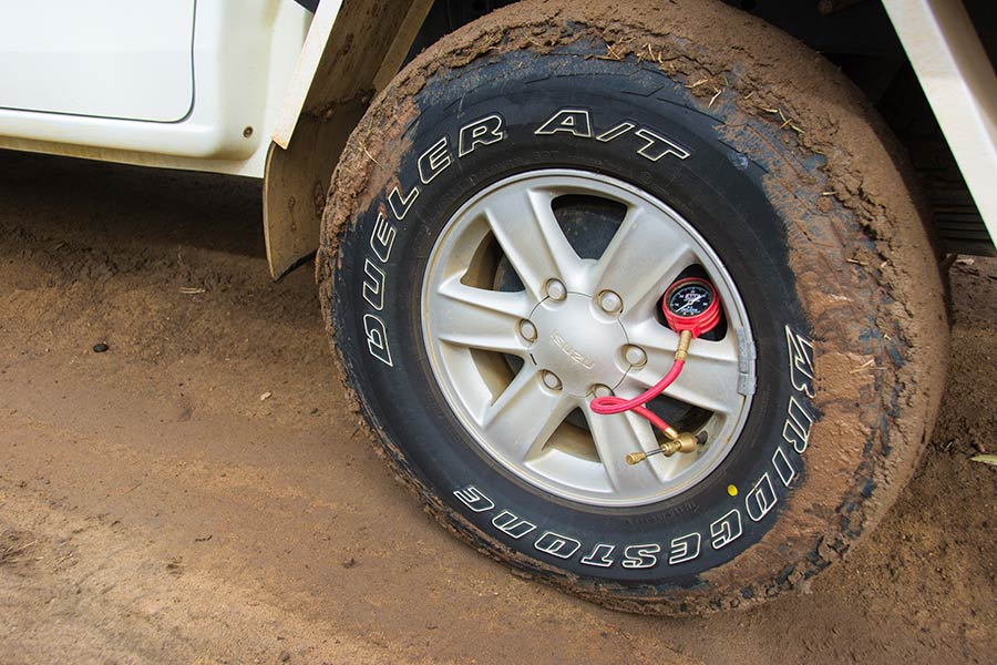 A tyre gauge attached to a 4WD wheel