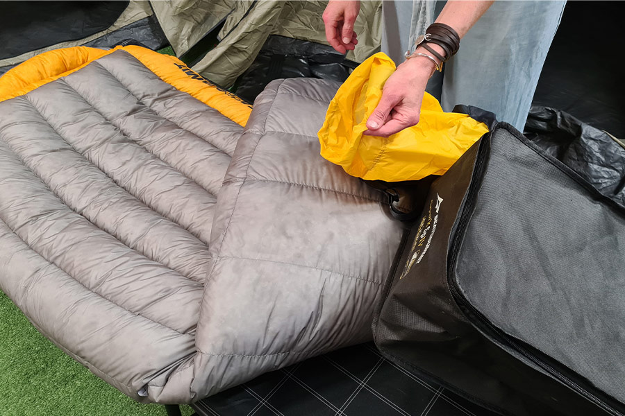 Sea to Summit's Spark Sp4 Sleeping Bag with yellow stuff sack and storage bag.