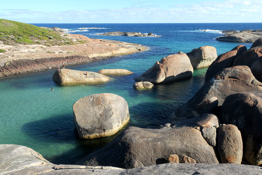 The coastal boulders of Elephant Rocks and the clear water of Greens Pool.