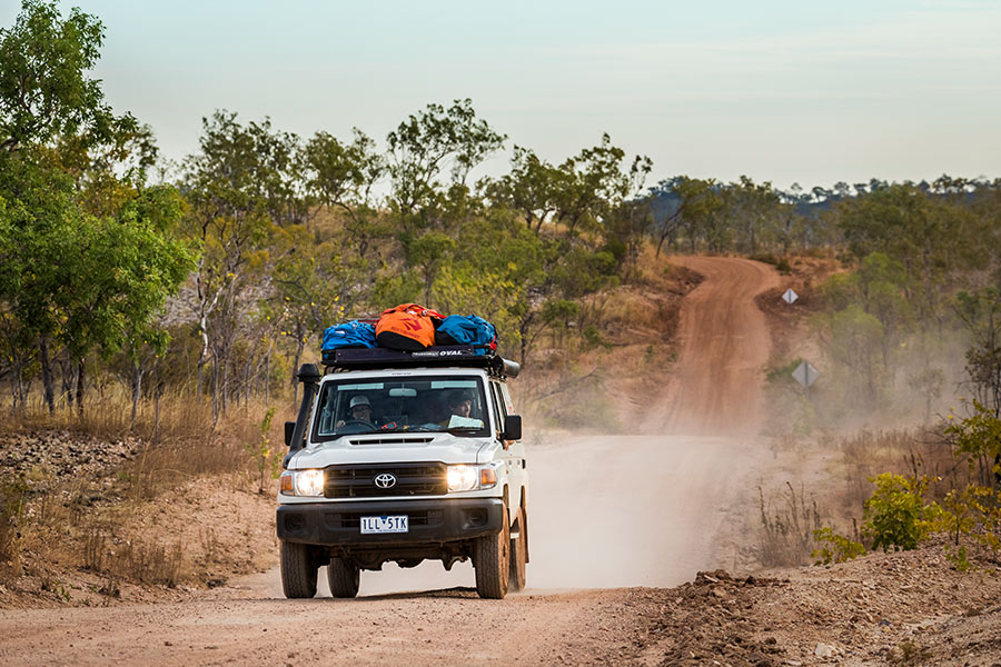 A 4WD driving down a dirt road in outback, Australia.