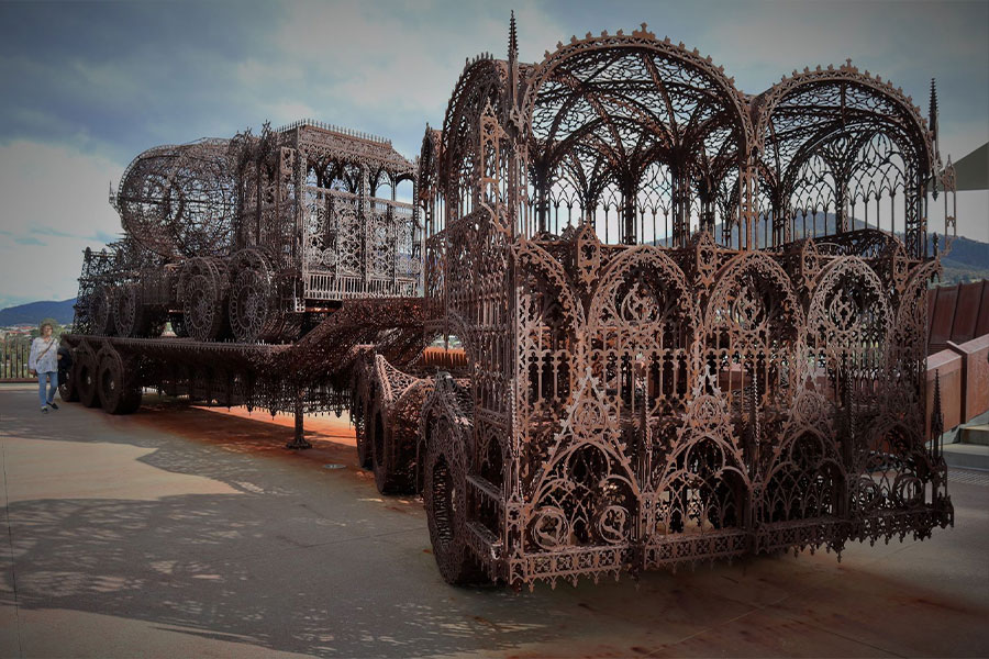 An incredible iron sculpture of live-size machinery designed completely from intricate filigree.